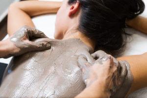 Beautiful-young-woman-having-clay-body-mask-apply-by-beautician.-611887754_5179x3453-300x200 Beautiful young woman having clay body mask apply by beautician.