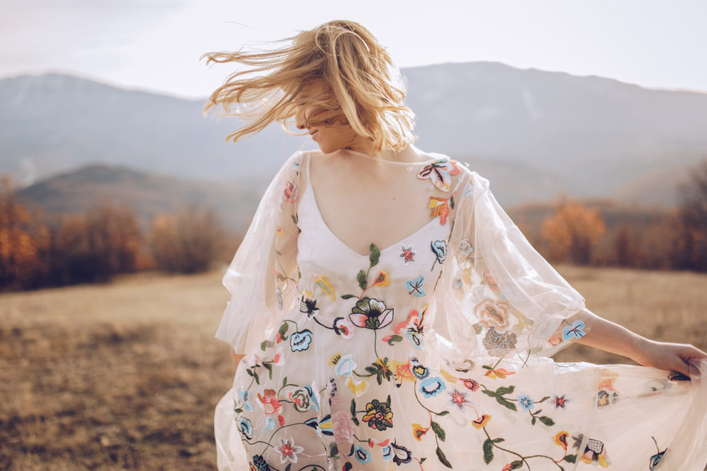 Beautiful-hippie-woman-dancing-in-a-meadow-880366686_6720x4480-1024x683 Ultimate Massage Practice- Built on your core values