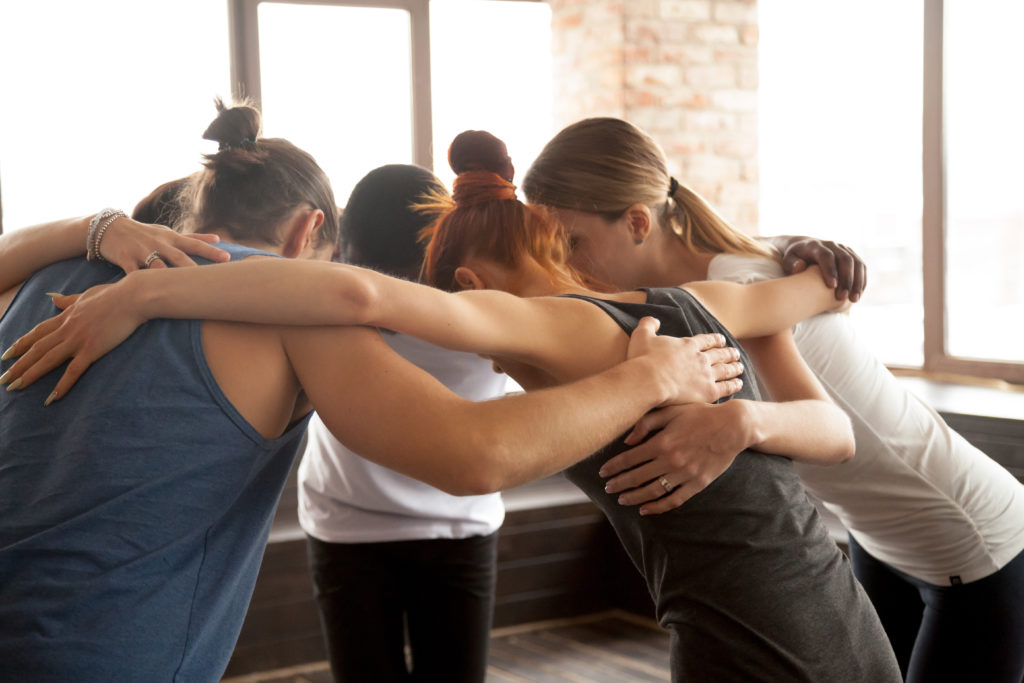 Young-people-embracing-in-circle-standing-together-group-unity-concept-922482666_5616x3744-1024x683 Health Span - Calgary Massage Therapy Company driven by Values