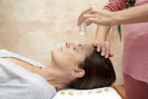 Mature-woman-receiving-crystal-healing-treatment-eyes-closed-200462150-001_4992x3328-300x200 crystal healing for chakra balancing