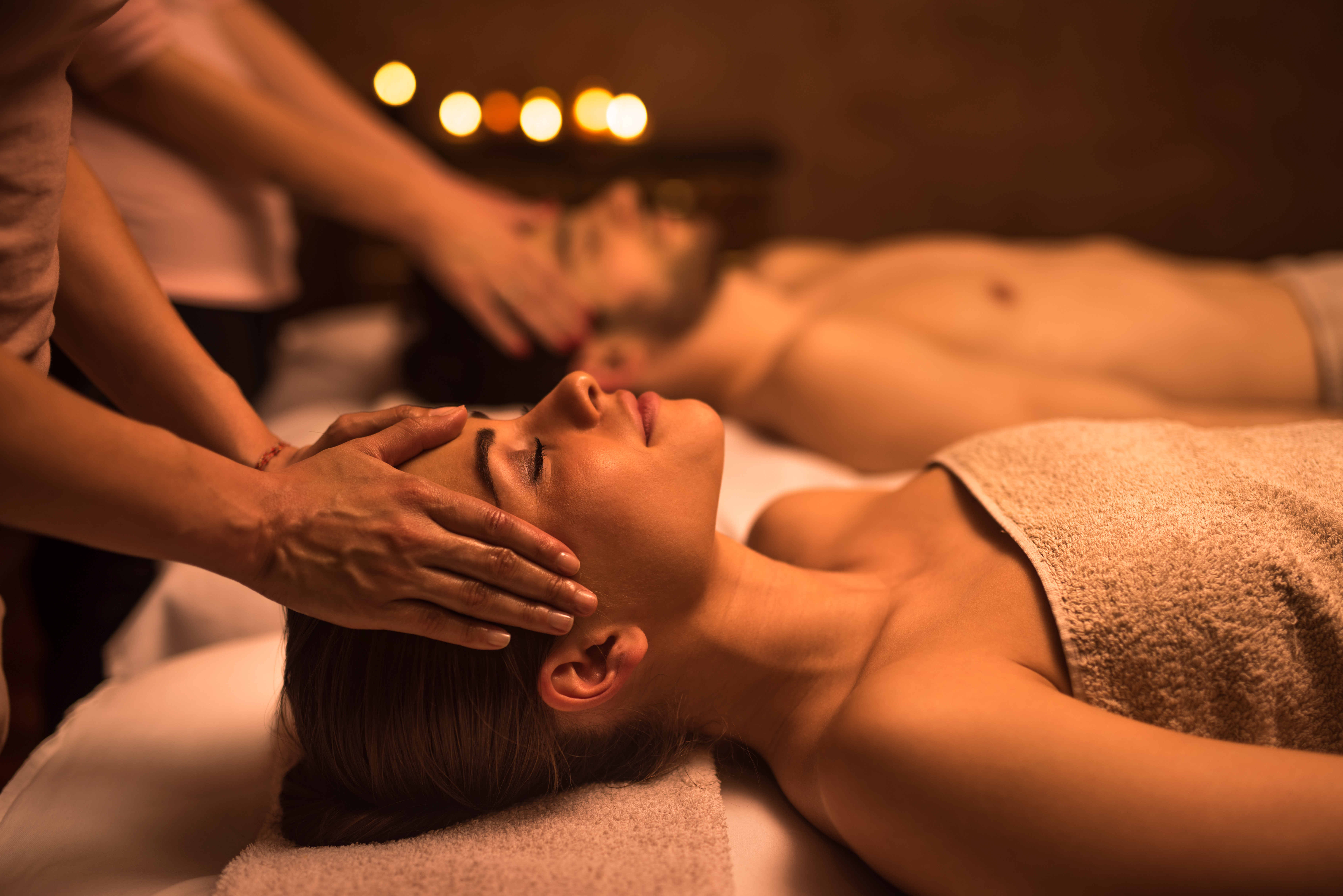 Young-woman-at-the-spa-enjoying-in-head-massage.-517796688_7360x4912 Young woman at the spa enjoying in head massage.